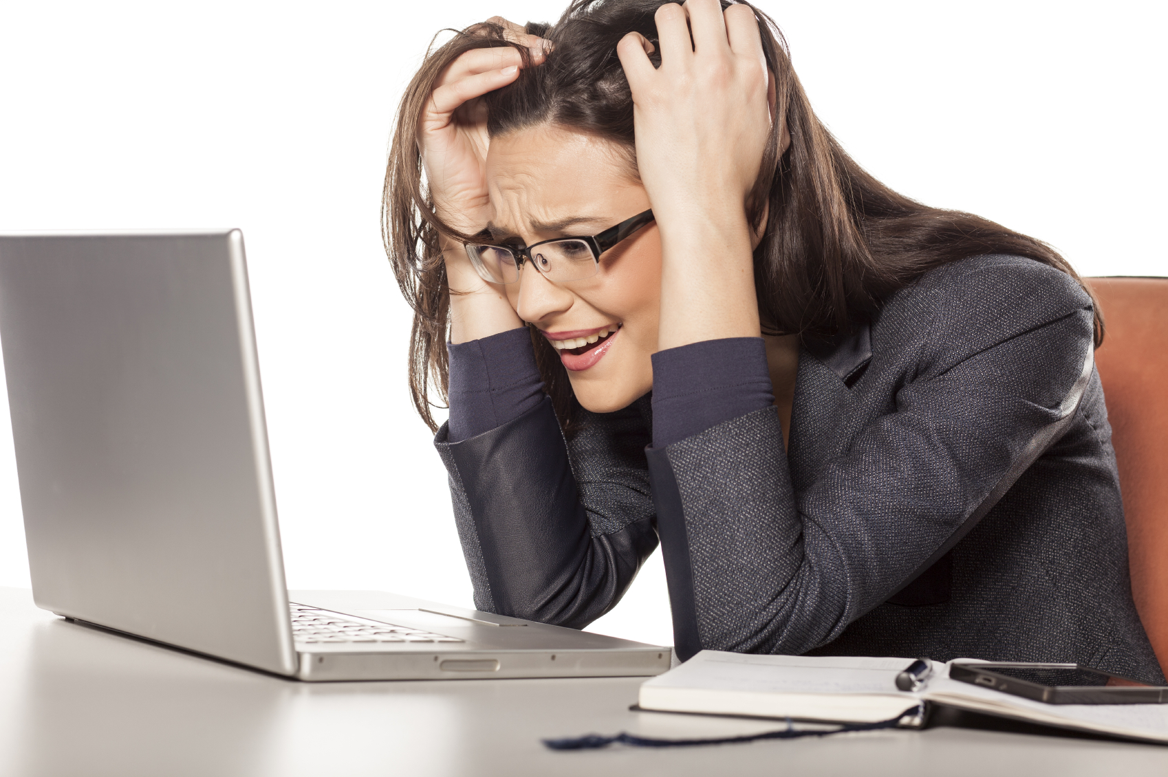 Shocked-young-businesswoman-looking-in-her-laptop-000058281204_Medium